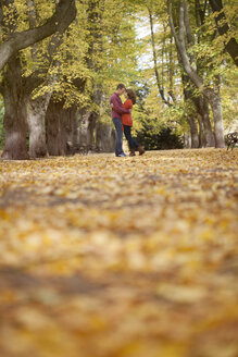 Happy young couple enjoying autumn in a park - BGF000031