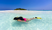 Maledives, young woman snorkelling in a lagoon - AMF001228