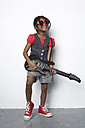 Girl with toy guitar wearing red heart-shaped sunglasses - FSF000310