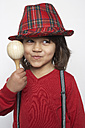 Portrait of smiling little boy with wooden rattle wearing hat and suspenders - FSF000313