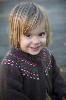 Portrait of smiling little girl wearing cardigan - LVF000333