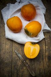 Kaki fruits on white cloth - LVF000339