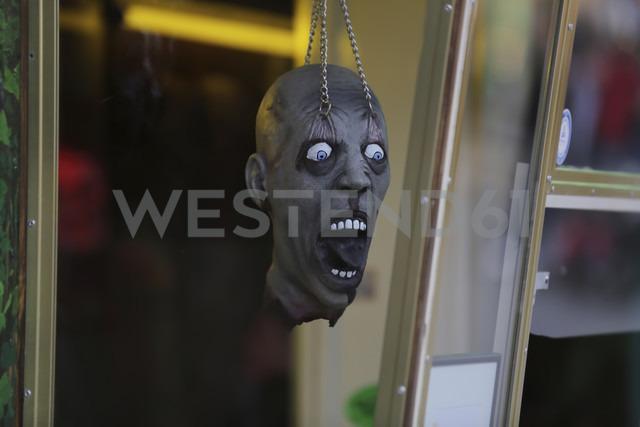Germany, North Rhine-Westphalia, Cologne, figurine head at till of ghost train - JAT000476