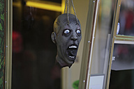 Germany, North Rhine-Westphalia, Cologne, figurine head at till of ghost train - JAT000476