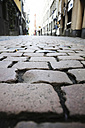 Germany, North Rine-Westphalia, Cologne, cobblestone pavement at historic city - JAT000480