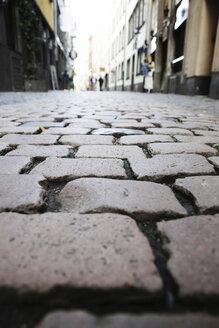 Germany, North Rine-Westphalia, Cologne, cobblestone pavement at historic city - JAT000480
