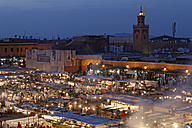 Morocco, Marrakesh, People at Djemaa el Fna square with Koutoubia Mosque at night - GF000308