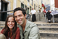 Portugal, Lisboa, Carmo, Calcada du Duque, portrait of young couple sitting at stairs - BIF000061