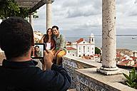 Portugal, Lisboa, Alfama, Miradouro de Santa Luzia, someone take a picture of young couple - BIF000067