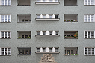 Germany, Bavaria, Munich, part of grey house front with windows, loggias and sculpture - AX000577