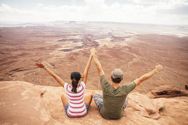 USA, Utah, Young couple looking over Canyonlands National Park - MBEF000889