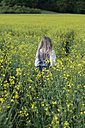 Germany, Bavaria, Starnberg, girl in a rape field - CRF002516