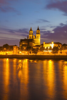 Germany, Saxony-Anhalt, Magdeburg, Cityscape with River Elbe and cathedral at dusk - WDF002085