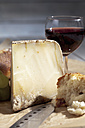 French Bethmale cheese, grapes, baguette and red wine glass - CS020371