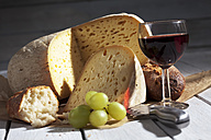 French Bethmale cheese, grapes, baguette and red wine glass - CS020374