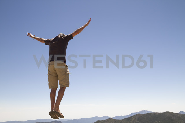 USA, Colorado, Rocky Mountain National Park, Man jumping in the air - MBEF000923