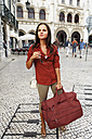 Portugal, Lisboa, Baixa, Rossio, Estacio do Rossio, young woman with travel bag - BIF000079