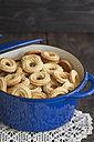 Taditional spritz cookies in blue cooking pot - ECF000403