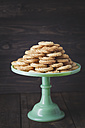 Traditional spritz cookies on green cake plate - ECF000390