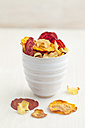 Bowl of roasted vegetable chips made of parsnips, sweet potatoes, beetroots, carrots and turnips - ECF000399