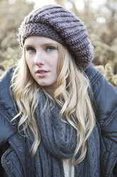 Portrait of young woman wearing wool cap - MAE007543