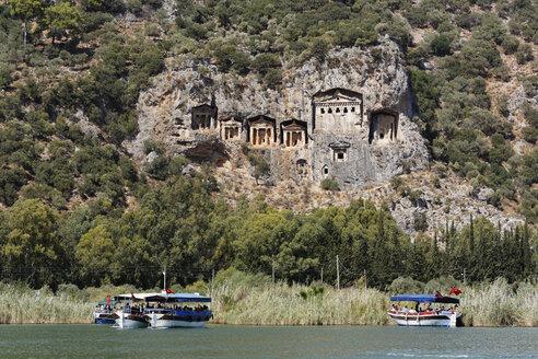 Turkey, Dalyan, Tourboats at Lycian Rock Tombs of Kaunos - SIE004745