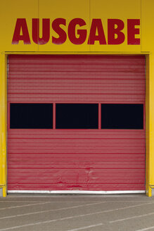 Germany, part of facade with red roller shutter of a wrapping counter - VI000008