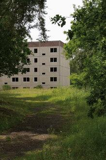 Germany, Brandenburg, Wustermark, Olympic village 1936, facade of decaying concrete tower block - VI000079
