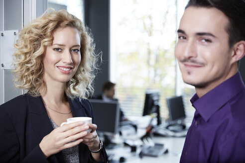 Germany, Neuss, Business people chatting in office - STKF000823
