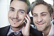 Germany, Neuss, Two young businessmen on the phone - STKF000850
