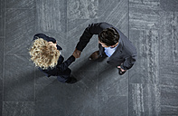 Germany, Neuss, Business people shaking hands - STKF000766