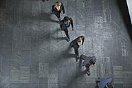 Germany, Neuss, Business people walking in a row - STKF000760