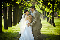 Happy bride and groom outdoors - PA000075