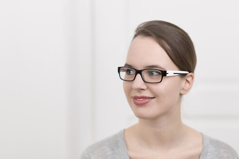 Young woman with glasses thinking - DRF000318