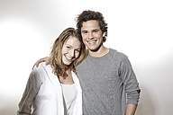 Portrait of happy young couple, studio shot - FMKF000946