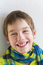 Portrait of smiling young boy with hoodie jacket and scarf - LVF000372