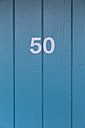 Germany, Number on a wooden door at a bath - MSF003146