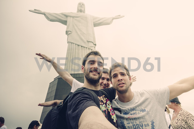 Brazil, Rio de Janeiro, Corcovado, Group of tourists in front of Jesus Christ the Redeemer statue - AMC000022