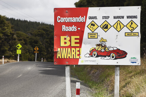 New Zealand, Coromandel Peninsula, Attention sign at costal road - GW002427