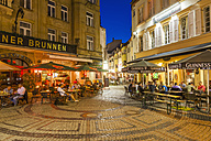 Germany, Hesse, Wiesbaden, People in cafes and restaurants in the old town at night - WD002124