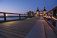 Germany, Mecklenburg-Western Pomerania, Rugia, view to sea bridge at Baltic seaside resort Sellin by twilight - PA000158