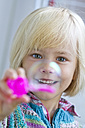 Portrait of smiling little girl with soap bubble - JFEF000257