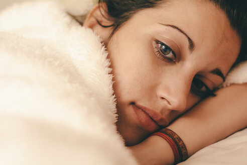 Young woman resting in bed and thinking about something - AMCF000028