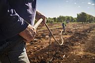 Australia, Carnarvon, Farmer installing irrigation system - MBE000967