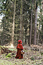 Little girl masquerade as Red Riding Hood standing in the wood - CLPF000032