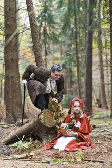 Man representing the wolf meeting girl masquerade as Red Riding Hood - CLPF000046