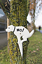 Prohibition sign for dog owners at tree trunk - HLF000302