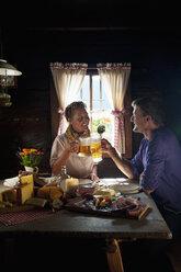 Austria, Salzburg State, Altenmarkt-Zauchensee, couple having an alpine picnic at alpine cabin - HHF004724