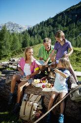 Austria, Salzburg State, Altenmarkt-Zauchensee, family with to children having a picnic - HHF004726