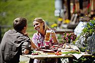 Austria, Salzburg State, Altenmarkt-Zauchensee, couple having an alpine picnic - HHF004730